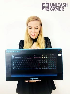 baabuska holding the Logitech G213 - one of the best gaming keyboards